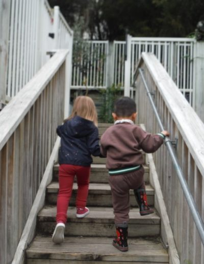 chloe and another going up stairs - friendship